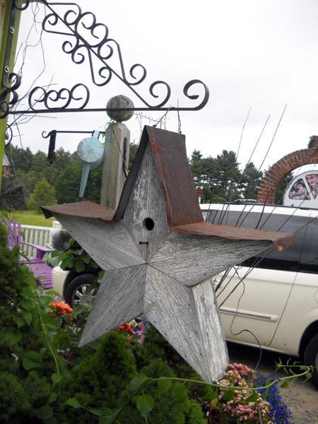 Adding A Decorative Birdhouse To The Garden May Spark A Hobby.