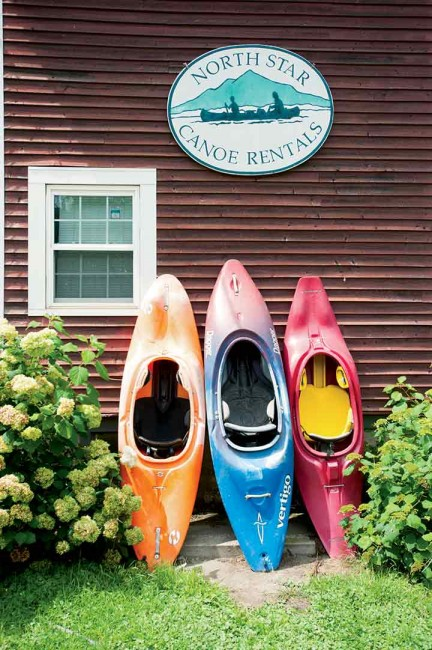 A trio of colorful kayaks await paddlers at North Star Livery in Cornish, New Hamp­shire.