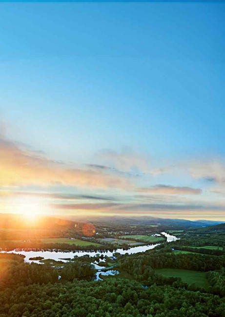 It's up, up, and away as Brian Boland's hot-air balloon takes you over the verdant Upper Valley, where the Connecticut River forms the border between the Granite and Green Mountain states.