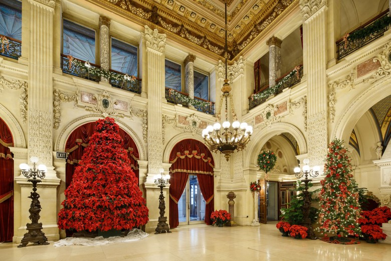 The grand poinsettia tree in The Great Hall at The Breakers.