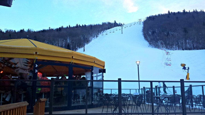 Enjoy a beer or a snack at the Roaring Brook Umbrella Bar after a long day on the slopes.