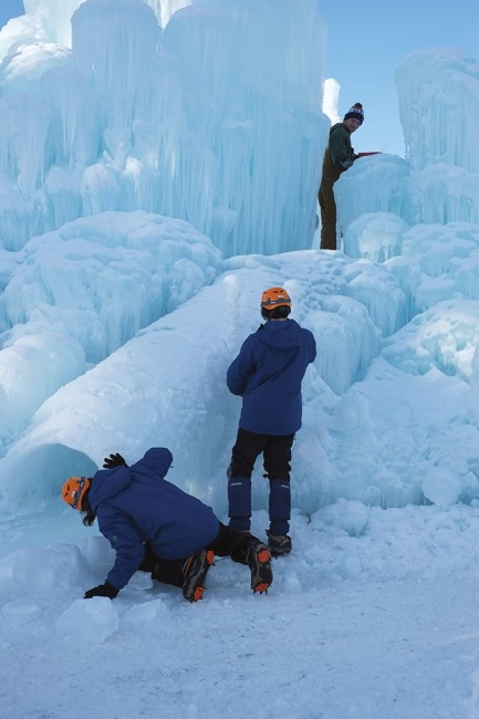 A trio of ice wranglers manage the ice slide.