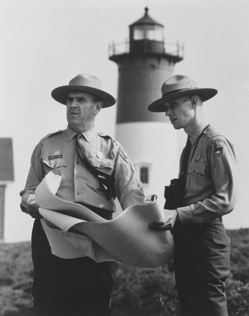 Robert F. Gibbs, who became the first superintendent of the Cape Cod National Seashore on April 8, 1962, is seen here with First Chief Ranger Van der Lippe with Nauset Light seen in the distance.