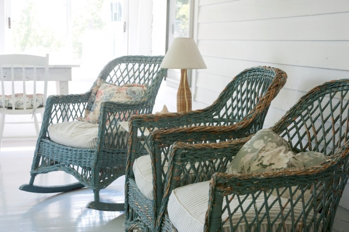 Looking out toward the nearby barns and mountains, vintage wicker rocking  chairs grace the porch - Wicker Furniture New England's Gifts - New England Today