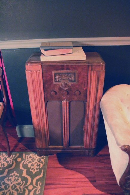 An old radio tucked in a corner. codex nashua speakeasy