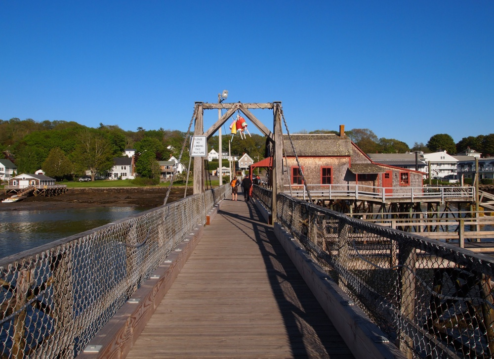 Cross the famous footbridge to get an on-the-water glimpse of the harbor.