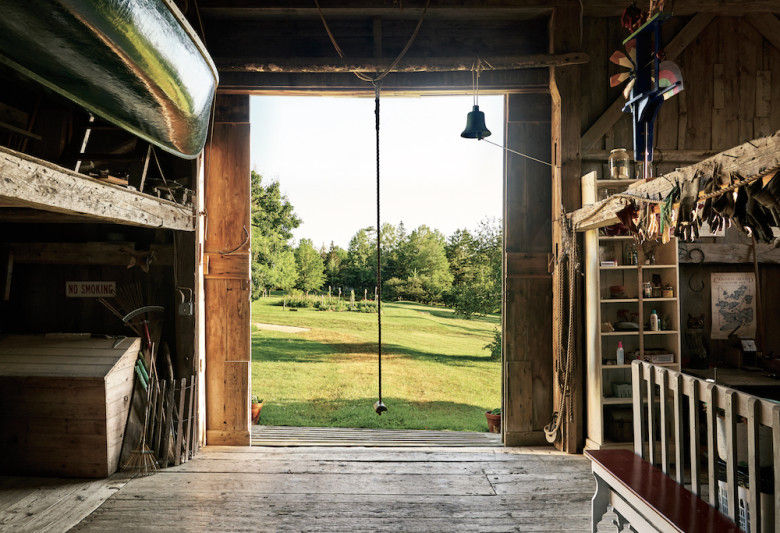 The interior of the barn, looking out to the fields. Hanging in the doorway is the rope swing made famous in E.B. White's 1952 children's classic, Charlotte's Web.