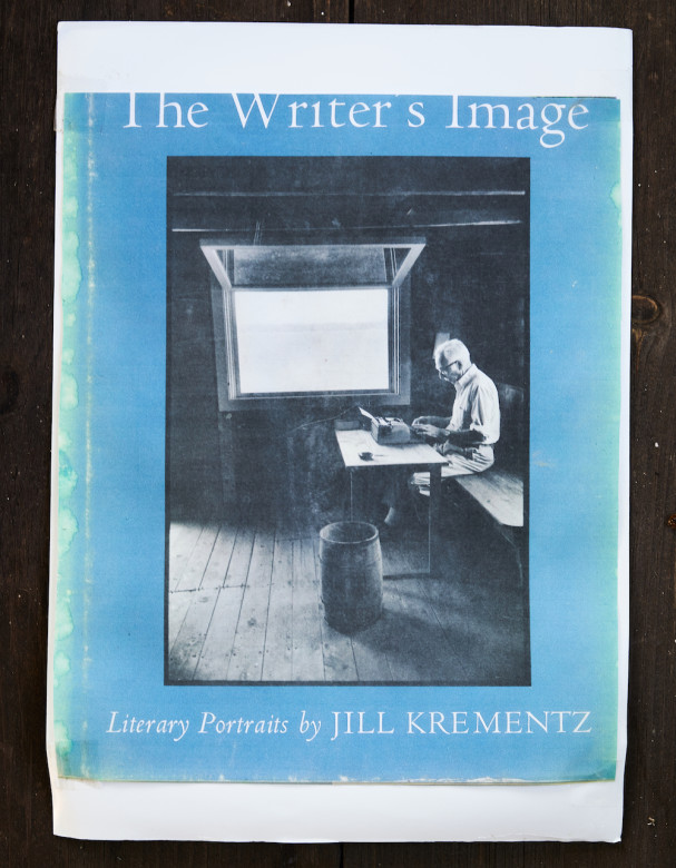 The cover of this Jill Krementz photography book shows E.B. White working in the boathouse in 1976. His bench, table, and wastebasket are still there today.