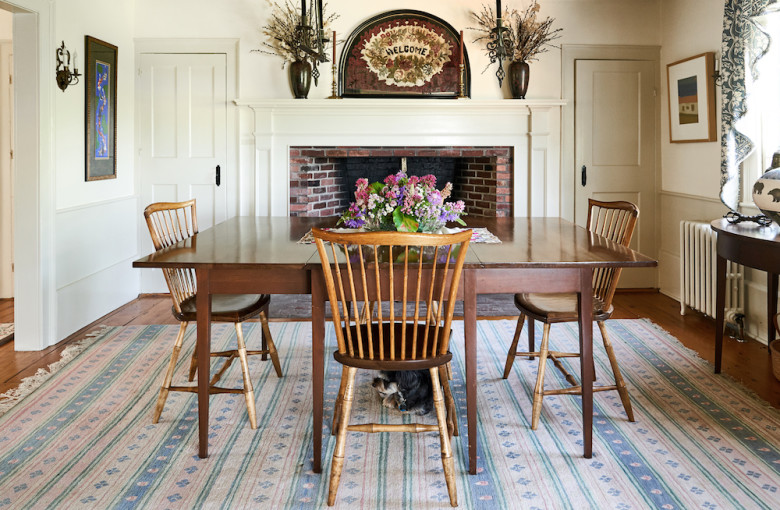 The dining room features one of the farmhouse's six working fireplaces.