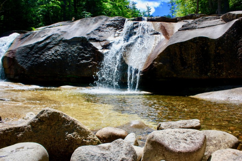 Water from Lucy Brook plunges over granite boulders.