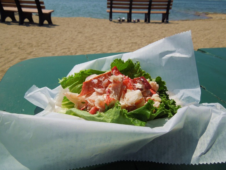 Mac's Seafood serves up a lightly seasoned, healthy lobster roll with a large piece of lettuce as garnish.