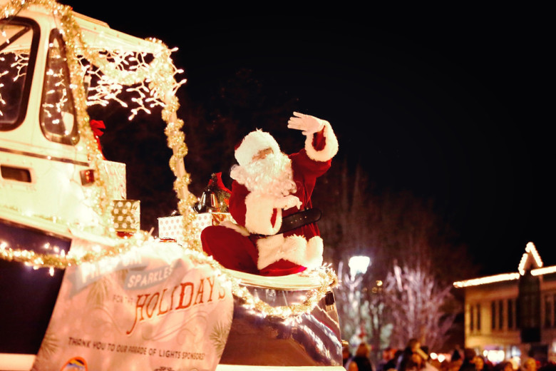 santa arrives by boat at the freeport sparkle festival