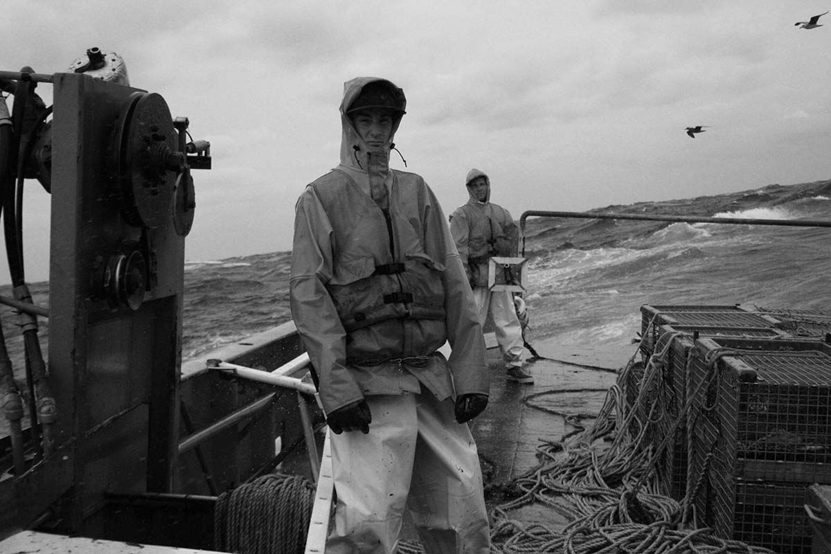 Standing By On a blustery autumn day, the boys wait for the cue from the wheelhouse to let the south end go. Foreground - Roger Raymond Background - Dennis Pollak on board the F/V Carol Coles - Portsmouth, NH