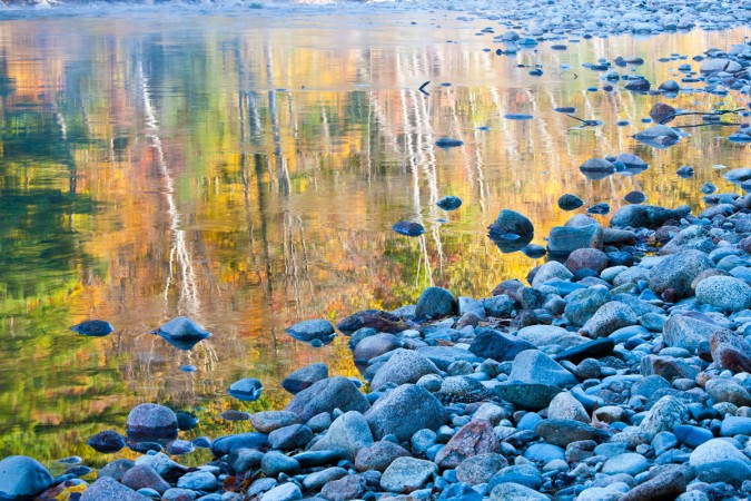Fall colors reflected in the Saco River, Bartlett, New Hampshire