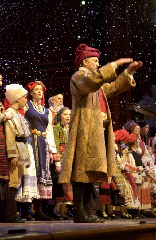 david coffin leads the audience and ensemble in the sussex mummers carol at - The Christmas Revels