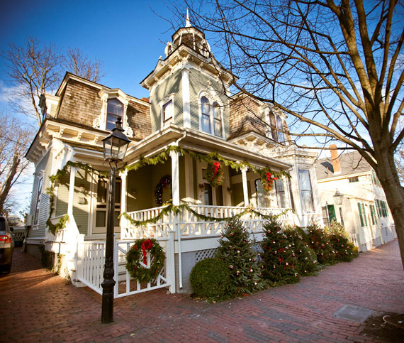 a private residence in town is adorned in christmas greenery