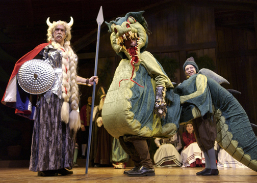 scene from the comic mummers play siegfried and the dragon with donald a - The Christmas Revels