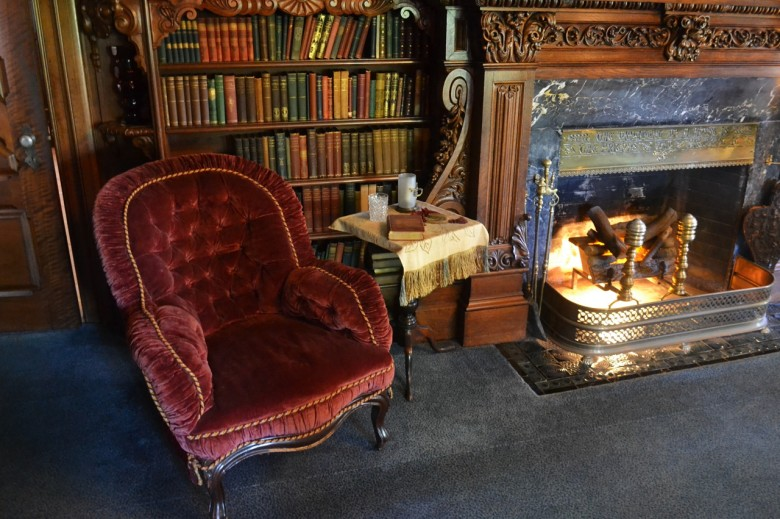 "But first, pause to admire the cozy reading chair in front of the fire. The library was considered ""the social center of the house."""