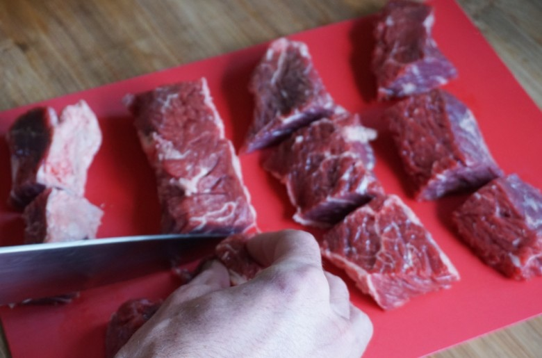 First, cut the steak into grill-friendly tips.