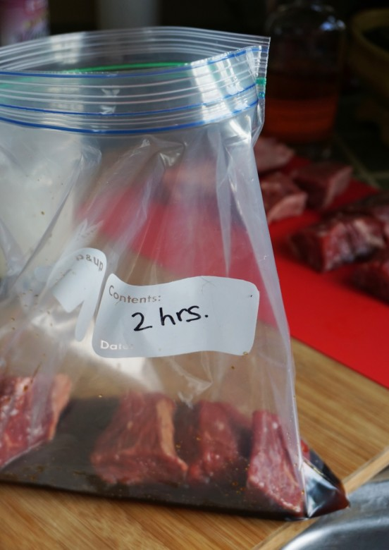 Add the meat and onion to the steak tip marinade in a zip-top bag.