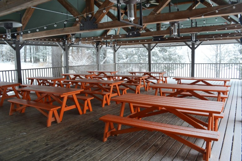 The outdoor dining patio at Picnic Social, the on-sire restaurant at Field Guide.