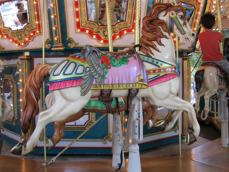 A beautiful hand-carved carousel horse, resembling that of Looff's Crescent Park Carousel.